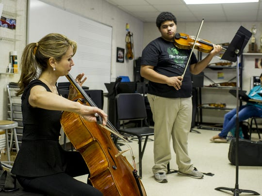 Cellist Allison Eldredge leads a master class hosted