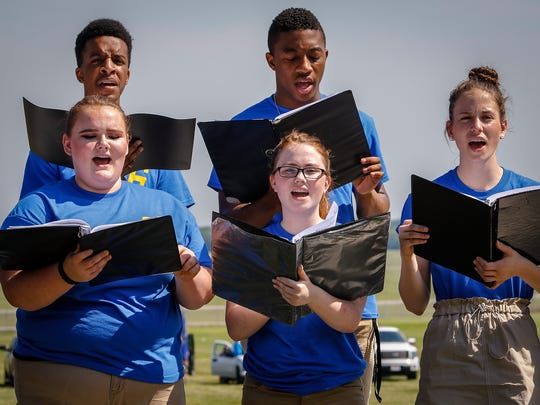 The Stewarts Creek High Chorale performed at Saturday's dedication to Capt. Jeff. Kuss.