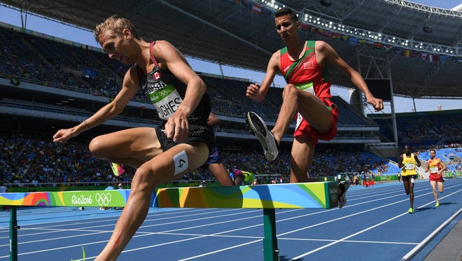 Aug 15, 2016; Rio de Janeiro, Brazil; Matthew Hughes (CAN) and Soufiane Elbakkali (MAR) compete in the men's 3,000m steeplechase athletics event at Estadio Olimpico Joao Havelange during the Rio 2016 Summer Olympic Games. Mandatory Credit: Kirby Lee-USA TODAY Sports