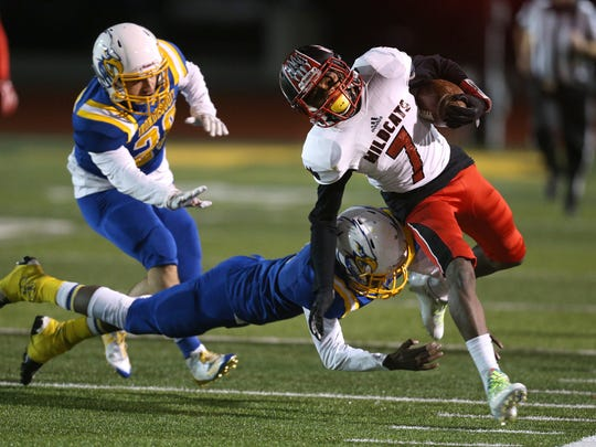 Wilson's Nasir King Jr. (7) is tackled by Irondequoit's Ja'Ron Frith.