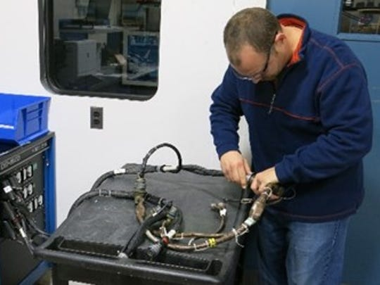 Letterkenny Munitions Center Electronic Measurement Equipment Mechanic, Chad Reams, tests an ATACMS interface cable using DIT-MCO test equipment.
