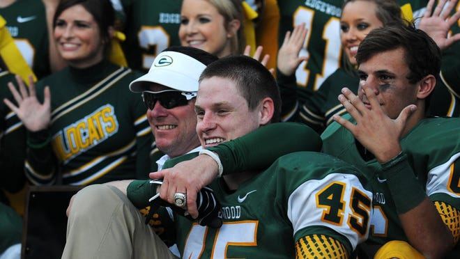 Edgewood coach Bobby Carr celebrates with Jesse Benton (45) after defeating Marengo Academy in the AISA Class AA Championship Game in Troy last year.