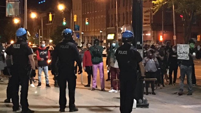 Erie police have charged two city residents with an attack on a man on State Street during rioting on May 30. One man is charged with shooting the victim and the other is accused of knocking him to the ground.
