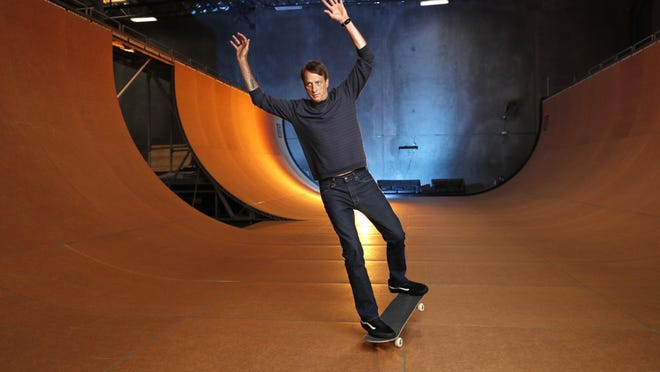 Skateboarding legend Tony Hawk stands on his ramp at his warehouse on Aug. 31 in Vista, California.