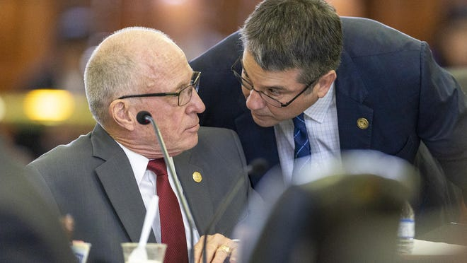 State Sen. Charles Perry, R-Lubbock, speaks with Sen. Bob Hall, R-Edgewood, in the Senate in March 2019.