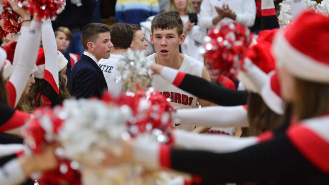 Metamora's Thomas Hall is introduced before a high school game.