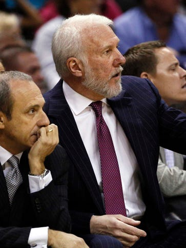 Assistant Ettore Messina, left, will coach the Spurs