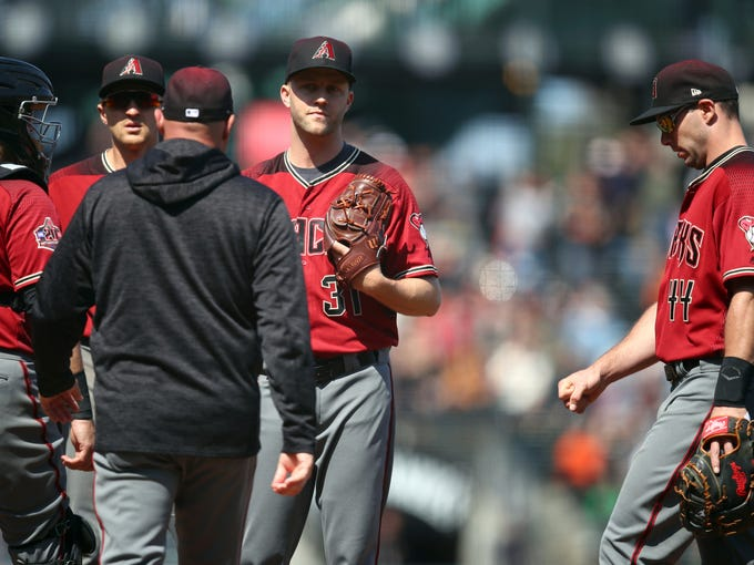 Arizona Diamondbacks' Brad Boxberger, center, is visited