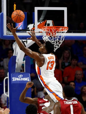Florida Gators forward Kevarrius Hayes (13) tips the ball in during the first half against the Arkansas Razorbacks.