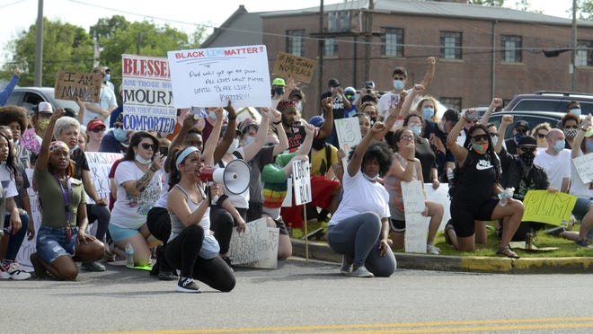 Protesters kneel and chant outside the Etowah County Detention Center during a Black Lives Matter march in Gadsden on Sunday.