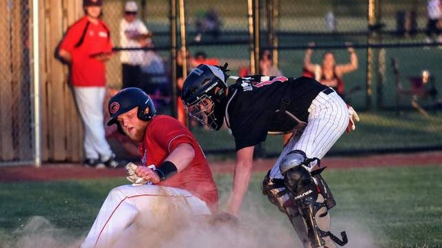 Roland-Story catcher Mark Dawson tags out Gilbert's Hudson Bellon at the plate during the second inning of the Norsemen's 9-5 victory over the Tigers in the second game of a doubleheader in Gilbert Wednesday. Dawson and sophomore Thomas Matthes both came over to Roland-Story from Eagle Grove after the Eagle Grove school board voted against holding a baseball season due to COVID-19. They've both made big contributions in a 6-2 start for the Norsemen. Photo by Joe Randleman/Ames Tribune.