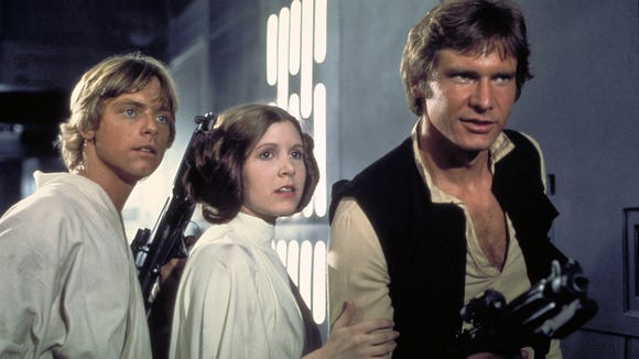 The core trio in the 'Star Wars' saga: Mark Hamill (as Luke Skywalker), Carrie Fisher (as Princess Leia Organa) and Harrison Ford (as Han Solo) in 'A New Hope.'