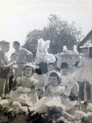 The Wallett and Doucet children ride on the float they built for the 1955 Easter Parade. Their float won first prize in the Junior Division Float Contest.