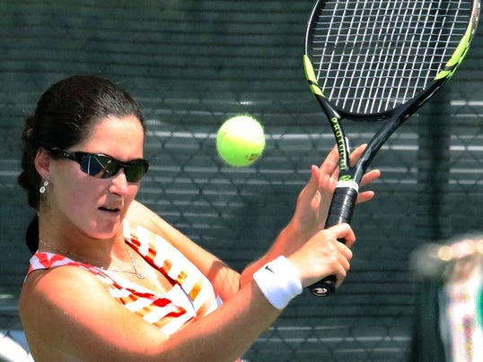 Jamie Loeb returns a shot to Jennifer Brady during the Hunt 2015 $25,000 Woman's Tennis Classic finals Sunday at Tennis West. Loeb is the current NCAA woman's tennis champion.