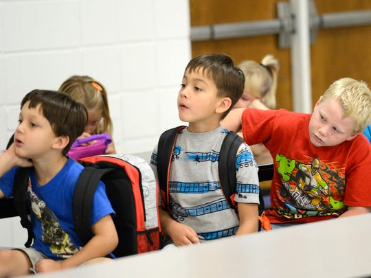 Students at Cotter listen to directions during the first day of school last year.