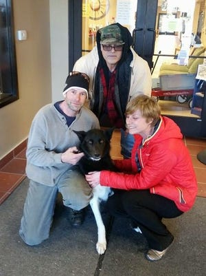 Alfredson, Betancourt and Borgmann enjoy receiving their dog, Decoy, after he was held by the Door County for over a month.