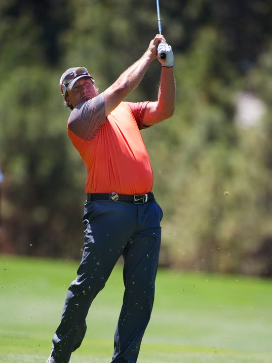 Former NHL player Jeremy Roenick hits from the fairway during the American Century Championship golf tournament Saturday, July 19, 2014, at Edgewood Tahoe Golf Course in Stateline, Nev. (AP Photo/Reno Gazette-Journal, Hilary Swift)