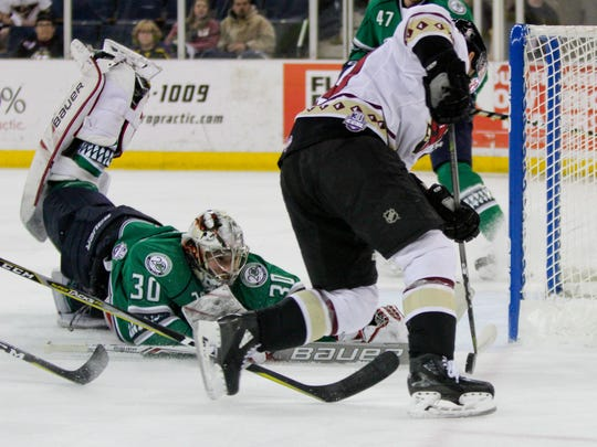 Atlanta Gladiators forward Lindsay Sparks (10) can't corral a puck at the post as Florida goaltender Callum Booth tries to dive back in time during a first-round playoff game at Infinite Energy Arena in Duluth, Ga., on Thursday, April 19, 2018.