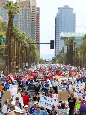 Thousands march in support of gun control during the March for Our Lives in Phoenix, Arizona,  on March 24, 2018.