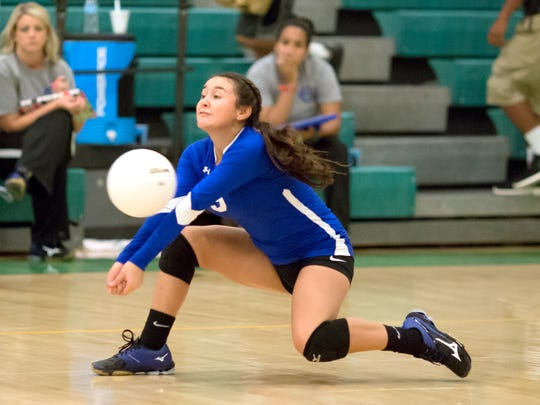 Carlsbad's Marissa Reyes digs one out Tuesday at Mayfield.