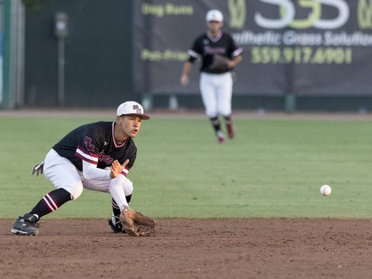 Mt. Whitney's Alex Partida fields a batted ball from