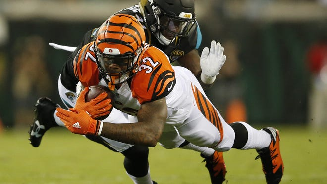 Bengals running back Jeremy Hill dives forward for extra yards in the first quarter.