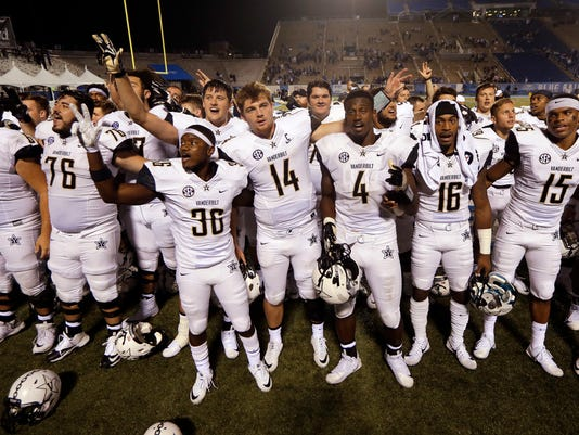 Vanderbilt players, including quarterback Kyle Shurmur (14), sing the school alma mater after defeating Middle Tennessee 28-6 in an NCAA college football game Saturday, Sept. 2, 2017, in Murfreesboro, Tenn. (AP Photo/Mark Humphrey)