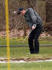 Nick Axelson of Roxbury chips onto the green during Morris County Tournament golf at Flanders Valley Golf Course April 23, 2015. Flanders, N.J. Bob Karp/Staff Photographer.