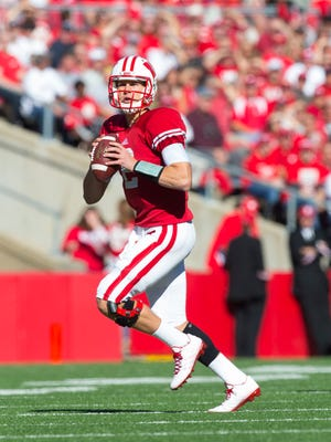 Wisconsin quarterback Joel Stave was the starter a year ago, completing 61.2 percent of his passes while helping the Badgers average 34.8 points. Now he splits time with Tanner McEvoy.