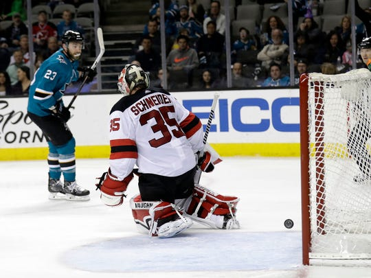 New Jersey Devils goaltender Cory Schneider (35) gives up a goal to San Jose Sharks' Barclay Goodrow (23) during the second period of an NHL hockey game Tuesday, March 20, 2018, in San Jose, Calif. (AP Photo/Marcio Jose Sanchez)