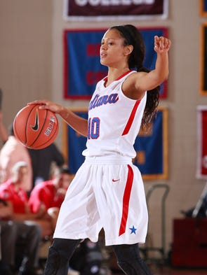 Indiana Girls All-Star Ana Owens calls the offense from mid-court as the Kentucky Girls Basketball All-Stars played the Indiana Girls All-Stars, Friday, June 13, 2014, in Lexington.