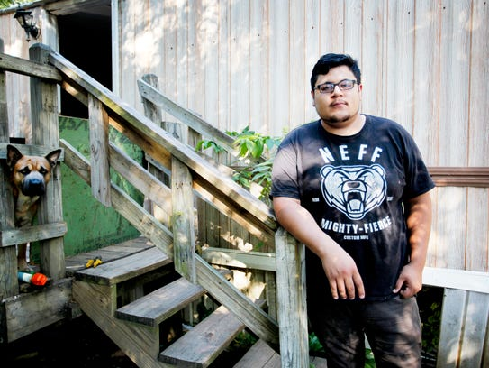 Uriel Ramerez stands outside his home at Lakeview Mobile