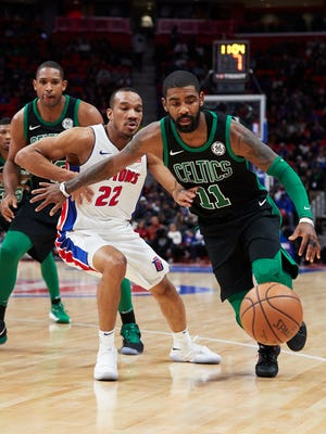 Celtics guard Kyrie Irving dribbles around Pistons guard Avery Bradley in the first half at Little Caesars Arena on Sunday.