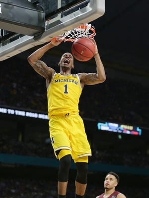 Michigan's Charles Matthews dunks in the second half of the national semifinal against Loyola-Chicago on Saturday, March 31, 2018, at the Alamodome in San Antonio.