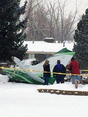 A look at what's left of a Cessna 404 that crashed feet away from a home about 1.5 miles from Centennial Airport southeast of Denver.