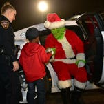 Grinch arrested after 5-year-old's heroic 911 call to save Christmas