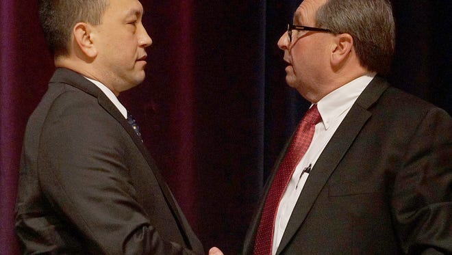 Jerry Botdorf and Sheriff Steve Sheldon shake hands at the conclusion of Thursday night's debate.