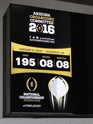 A clock will help visitors count down the time until the NCAA Championship Playoff Game in Glendale on Jan. 11, 2016.