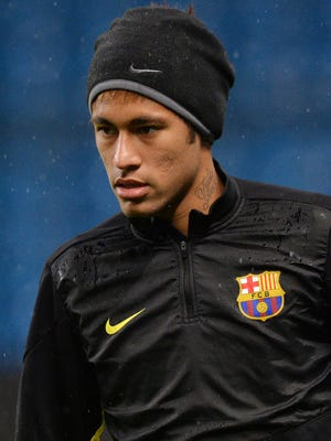 Barcelona's Brazilian forward Neymar takes part in a training session at The Etihad Stadium in Manchester, north west England, on February 17, 2014.
