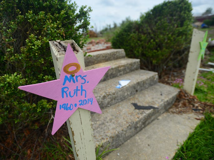 A star placed on a post outside the flattened rubble of Ruth's Daycare in Louisville remembers owner Ruth Bennett who was killed protecting 4-year-old Ashtyn Rose Mitchell during the April 28 tornado that ripped through Winston County.