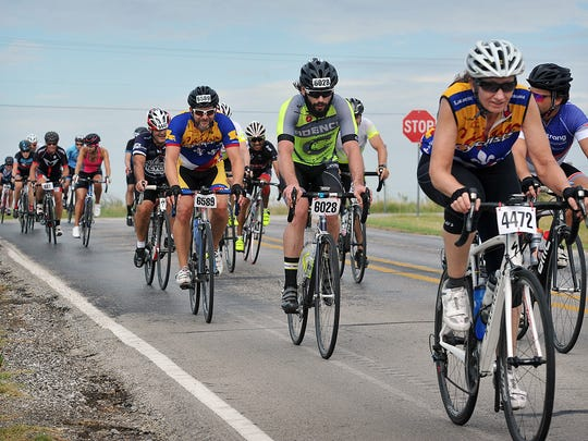 A group of 100-milers head east on FM 1177 after leaving Burkburnett Saturday during the Hotter 'N Hell Hundred.