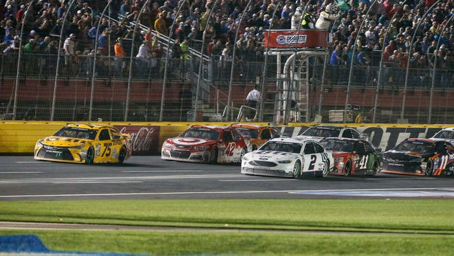May 21, 2016; Concord, NC, USA; Sprint Cup Series drivers Kyle Busch (75) and Kevin Harvick (4) lead the way down the front stretch after a caution during the Sprint All-Star Race at Charlotte Motor Speedway.