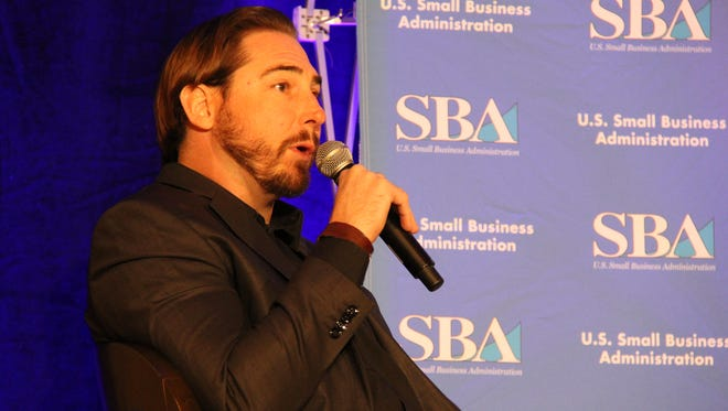 Eli Crane, CEO of Bottle Breachers, speaks to a crowd of small business owners about his success as an entrepreneur.