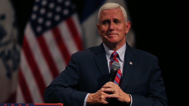 Mike Pence, republican vice presidential candidate, speaks to a crowd of people in an auditorium at the DMACC Newton campus, on Tuesday, Oct. 11, 2016.