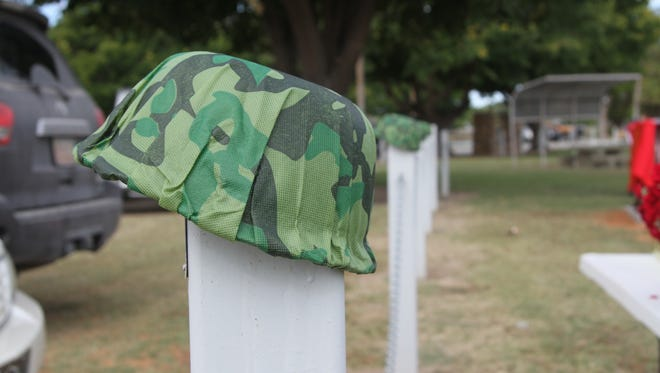 Replicas of military helmets on the post along the Carlsbad Veterans Memorial Park.