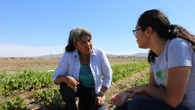 America Terrazas, left, a community leader with La Semilla's community education program La Cosecha, discusses crops and plans for the community garden in Vado-Del Cerro with La Semilla community and youth programs manager Marlene Catherine Yañez, at the La Semilla Community Farm in Anthony, N.M. on Saturday, March 18, 2017.