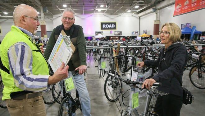 Steve Ikeler of the Hales Corners Wheel & Sprocket (left) helped Jeff Davis of Brookfield and his wife, Linda, find a pair of new bikes.