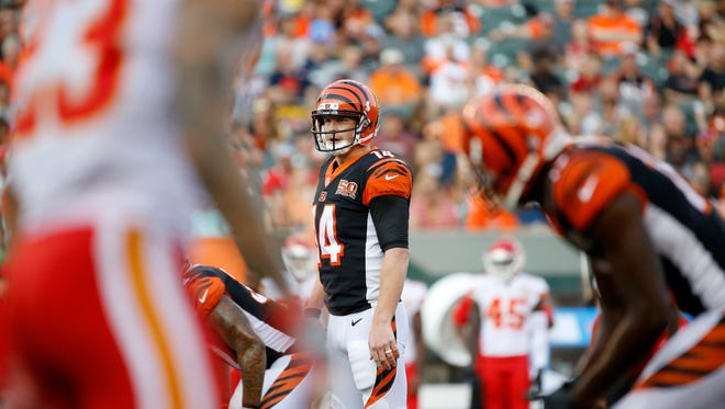 Cincinnati Bengals quarterback Andy Dalton (14) eyes the defense in the first quarter of the NFL Preseason Week 2 game between the Cincinnati Bengals and the Kansas City Chiefs at Paul Brown Stadium in downtown Cincinnati on Saturday, Aug. 19, 2017. At halftime the Bengals trailed 16-9.