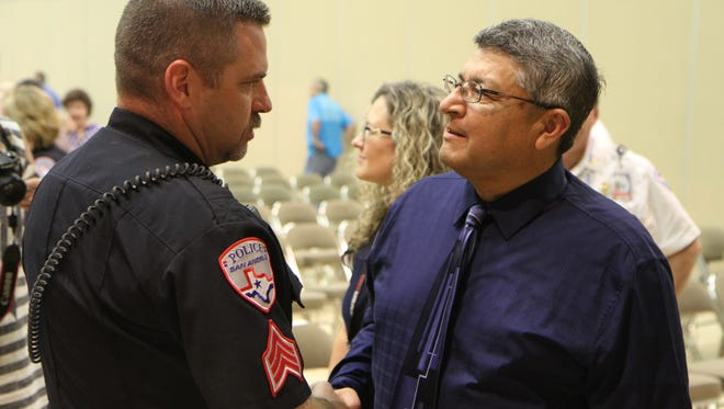 Sgt. Cory Moore shakes hands with Robert Martinez, longtime assistant chief for the San Angelo Police Department who was honored at a retirement ceremony on Friday, Oct. 6, 2017, at the McNease Convention Center.