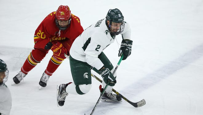 Michigan State's Zach Osburn skates up the ice in Friday's game against Ferris State. The Spartans won, 3-2, in overtime.